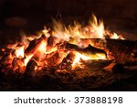 The Coals Of A Campfire In The...