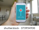 hand holding smart phone with... | Shutterstock . vector #373954930