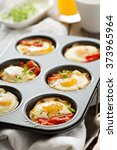 Baked Eggs With Ham And Tomato...