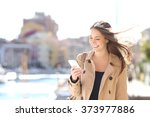 happy beautiful woman walking... | Shutterstock . vector #373977886