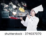 indian female chef cooking in... | Shutterstock . vector #374037070