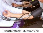 checking blood pressure | Shutterstock . vector #374064970
