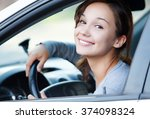 pretty girl in a car smiling to ... | Shutterstock . vector #374098324