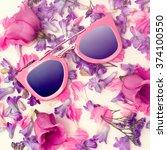 trend sunglasses on flowers... | Shutterstock . vector #374100550