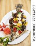 fried black pepper fish | Shutterstock . vector #374113444