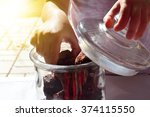 child hands opening a glass... | Shutterstock . vector #374115550