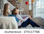 young cute mother having good...   Shutterstock . vector #374117788
