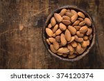 almonds in brown bowl on... | Shutterstock . vector #374120374
