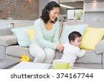 happy mother with baby daughter ... | Shutterstock . vector #374167744