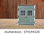 An Old Green Wooden Barn Door...