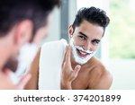 Handsome Man Shaving His Beard...