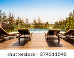 empty chair around swimming... | Shutterstock . vector #374211040