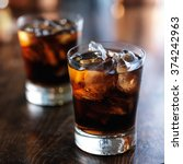 cold fizzy cola soda with ice... | Shutterstock . vector #374242963
