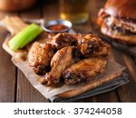 crispy barbecue chicken wings... | Shutterstock . vector #374244058