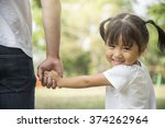 father and daughter holding... | Shutterstock . vector #374262964