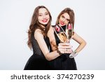 smiling two women in night... | Shutterstock . vector #374270239