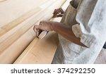 a man carpenter use measuring...   Shutterstock . vector #374292250