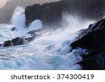 Waves Breaking Over Rocks Along ...