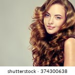 beautiful girl with long wavy... | Shutterstock . vector #374300638