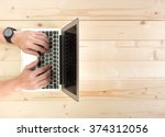male hands working on a laptop... | Shutterstock . vector #374312056