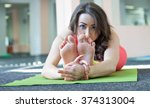 Young Girl Engaged In Yoga...