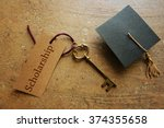 gold key with scholarship tag ... | Shutterstock . vector #374355658