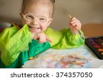 girl with down syndrome draws... | Shutterstock . vector #374357050