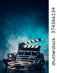 Small photo of Retro film production accessories still life. Concept of film-making. Smoke effect on background
