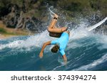 A Female Surfer In A Blue Rash...