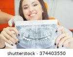 patient beautiful girl holding... | Shutterstock . vector #374403550