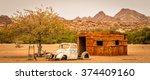 a namibian hut and a broken car ... | Shutterstock . vector #374409160