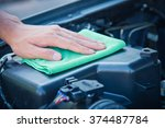 wipe cleaning the car engine... | Shutterstock . vector #374487784