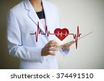 doctor holding tablet  with... | Shutterstock . vector #374491510
