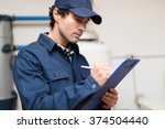 technician fixing an hot water... | Shutterstock . vector #374504440