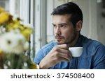 handsome man drinking coffee... | Shutterstock . vector #374508400
