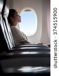 woman sleeping in an airplane.... | Shutterstock . vector #374515900