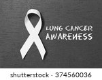 white ribbon. lung cancer... | Shutterstock . vector #374560036
