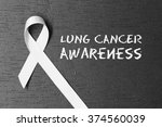 white ribbon. lung cancer... | Shutterstock . vector #374560039