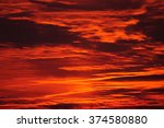 burning evening sky at sunset.... | Shutterstock . vector #374580880