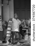 Small photo of Thailand 2016 Feb 6, man hawker sold postcard to tourist in front of the Grand palace,Bangkok Thailand.