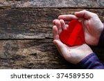 Man Holding A Broken Heart...