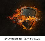 shield burning in fire | Shutterstock . vector #374594128