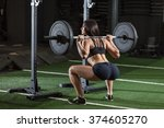 sportive woman doing squatting... | Shutterstock . vector #374605270