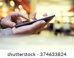 woman texting on cell phone in... | Shutterstock . vector #374633824