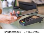 woman paying with nfc... | Shutterstock . vector #374633953