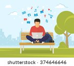 young man sitting in the park... | Shutterstock .eps vector #374646646