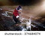 Little Boy Playing In Puddle I...