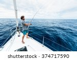 young man fishing in open sea... | Shutterstock . vector #374717590
