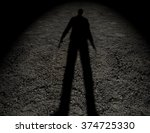 Shadow Of  A Man On The Ground...