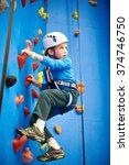 little boy is climbing to... | Shutterstock . vector #374746750
